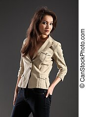 Long haired girl in khaki jacket