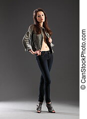 Girl posing in skinny jeans
