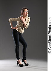 Sexy pose from girl in skinny jeans - Fashion pose of girl...