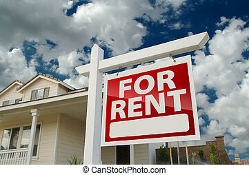 For Rent Real Estate Sign in Front of House