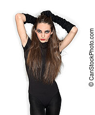 Young pretty lady in black combi dress and velvet gloves holding her hairs, ring flash studio portrait