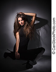 Young slim glamour lady with long hairs dressed in black...