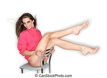 Coquettish sexy cute woman in pink blouse with long legs...