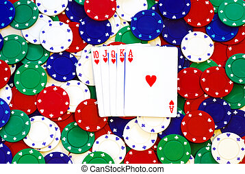 Royal Flush on poker chips making a background