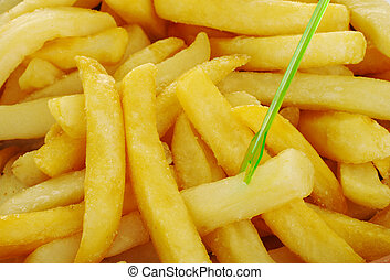 French Fries with Green Skewer - French fries with a green...