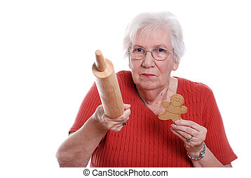 senior woman protecting gingerbread - isolated senior woman...