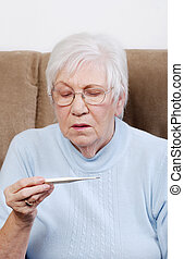 senior woman reading a thermometer