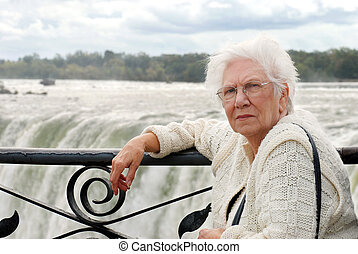 senior woman at edge niagara falls