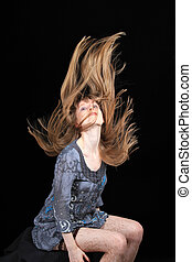 Blonde hair - Attractive young girl with wind in blonde hair