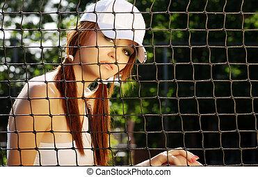 woman tennis player - portrait of a woman tennis player...