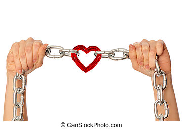 strong love - woman holding in the hands chain with heart as...