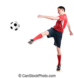 soccer player hits the ball - soccer player strongly hits...