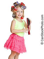 Little girl play hairdresser
