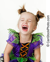 Laughing young little girl in colorful dress isolated on...