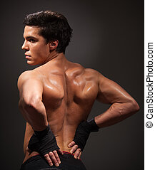 Body building - Back of a man with big mussels