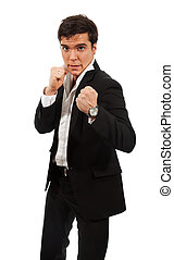 Fierce business - a man standing with fists and ready to...
