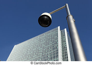 CCTV security camera near skyscraper building - Looking up...