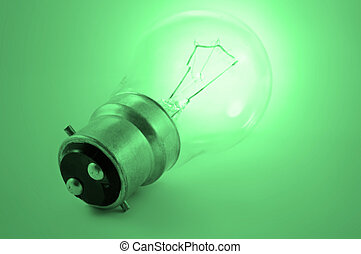 Green light - Close up of a single illuminated light bulb...