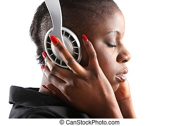 Woman lost in music - Black woman listening to music on...