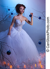 Christmas fairytale - Bride in a wedding dress walking...