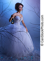Winter fairytale - Bride walking whit a lantern in the dream...