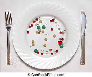 Vitamin diet - Vitamin photo on a white plate, the fork and...