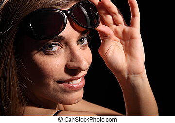 Woman wearing sunglasses - Beautiful smiling woman wearing...