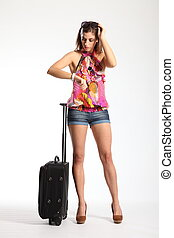 Sexy woman waiting with suitcase - Woman with sexy long...