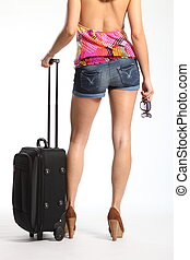 Sexy legs of woman with suitcase