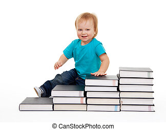 Happy kid sitting on the steps of books