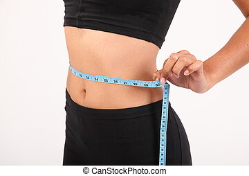Tape measure on slim waist - Tape measure around waist of...