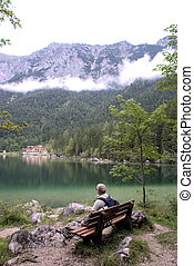 A hiker at the Hintersee - The Hintersee is a mountain lake...