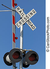 rail road crossing against a blue sky