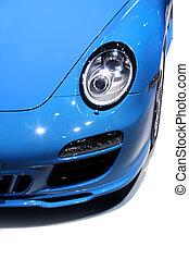 Car head lamp - Close up shot of blue sports car head lamp