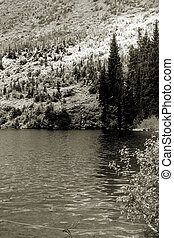 Scenic landscape in Sepia - Swift current lake in Glacier...