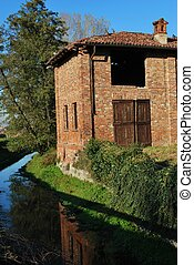 Old country house - Old abandoned country house on a canal...