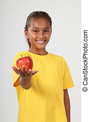 An apple from teachers favourite - Young school girl with a...