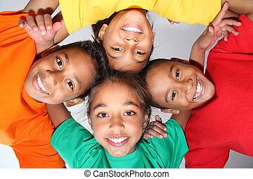 Playful school friends in huddle - Four young playful school...