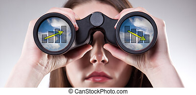 Business vision - A businesswoman looking through...