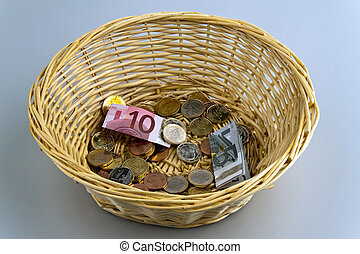 Donation basket for collection. - A donation basket for...