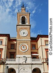 Double clock tower against blue sky, Rimini, Italy