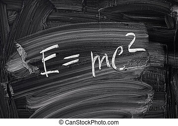 E=mc2. Theory of relativity, writings on blackboard.