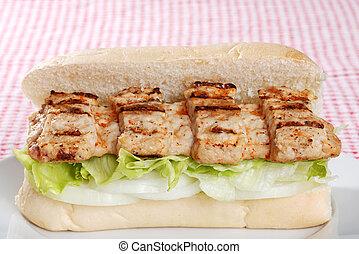 barbecue pork riblet on bun