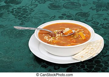 beef barley soup starter with a spoon