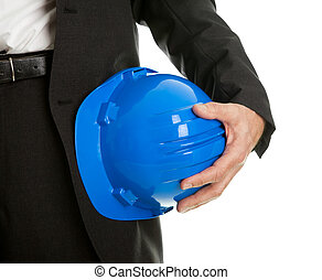 Close-up of architect/worker holding hard hat - Close-up of...