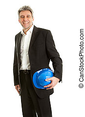Portrait of successfull architect wearing blue hard hat....