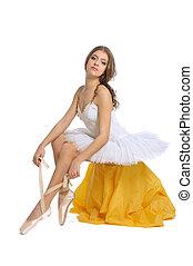 tying ballet slippers - ballerina tying her ballet slippers...