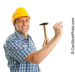 Confident worker hammering in - Confident worker wearing...
