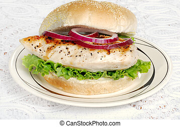 grilled chicken sandwich with onion - closeup of grilled...