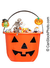 halloween pumpkin pail with candy - isolated halloween...